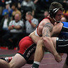 J.T. Brown of Elyria forces Trevor Nichelson of Ashland-Greenberg (Neb.) to the mat. Randy Meyers -- The Morning Journal