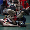 Elyria's Drew Butera avoids a pin by Nick Giantonio during a consolation match. Randy Meyers -- The Morning Journal