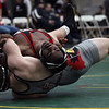 Cam King of Elyria bodies Tyler Stein of Canfield to the mat during the 195-pound consolation match at the Walsh Ironman. King won the match. Randy Meyers -- The Morning Journal
