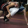 Mick Burnett of Elyria takes down Mosha Schwartz of Wyoming Seminary Pa. during the Walsh Ironman and advances to the semifinals. Randy Meyers -- The Morning Journal