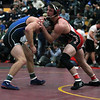 Elyria's J.T. Brown takes a hold advantage on Trevor Nichelson of Ashland-Greenwood  in Nebraska at the Walsh Ironman. Brown won this match and advanced to the semi-finals. Randy Meyers -- The Morning Journal