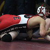 Elyria's Mick Burnett forces Mosha Schwartz of Wyoming Seminary, Pa.,  to the mat during the 106-pound match. Randy Meyers -- The Morning Journal