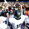 Monarch's Cole Watson holds up his fingers as #1's to fans after beating Denver South in the 4A State Football Championship football game in Denver, Colorado December 1, 2012. BOULDER DAILY CAMERA/ Mark Leffingwell