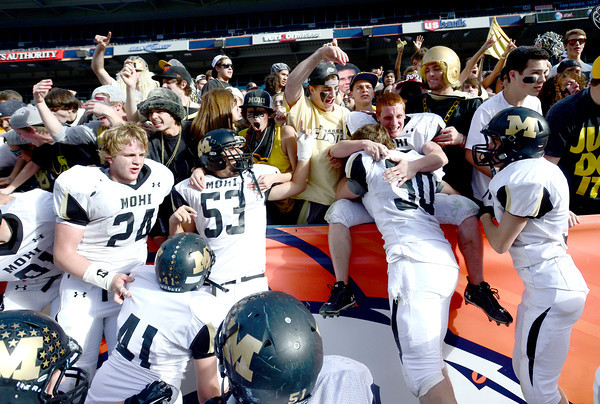 Monarch football players and fans celebrate Monarch winning the 4A State Football Championship football game against Denver South in Denver, Colorado December 1, 2012. BOULDER DAILY CAMERA/ Mark Leffingwell