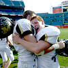 Monarch's Braden Pape (left) and Dylan Glazer (right) celebrate winning the 4A State Football Championship football game in Denver, Colorado December 1, 2012. BOULDER DAILY CAMERA/ Mark Leffingwell
