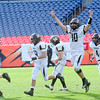 Monarch quarterback Cole Watson celebrates beating Denver South in the 4A State Football Championship football game in Denver, Colorado December 1, 2012. BOULDER DAILY CAMERA/ Mark Leffingwell