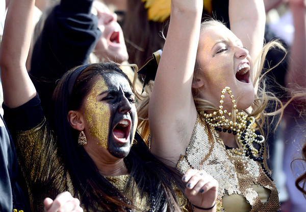 Jimena Mohedas (left) and Tori Ganahl (right) cheer on Monarch high  during their 4A State Football Championship football game against Denver South in Denver, Colorado December 1, 2012. BOULDER DAILY CAMERA/ Mark Leffingwell