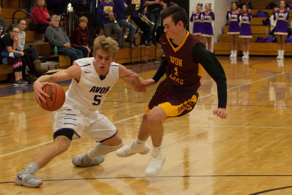 . Avon Lake\'s Nick Vittardi pressures Avon\'s Ryan Maloy (5) as he dribbles toward the Eagles\' basket. Jen Forbus -- The Morning Journal