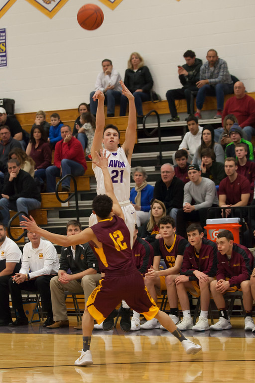 . Avon Lake\'s Jordan Ball defends against Avon\'s Dean Emerine as he shoots from 3-point territory. Jen Forbus -- The Morning Journal