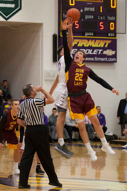 . Avon Lake post Nick Marsh and Avon forward Vlasi Pappas face off for the jump ball to start the contest. Jen Forbus -- The Morning Journal
