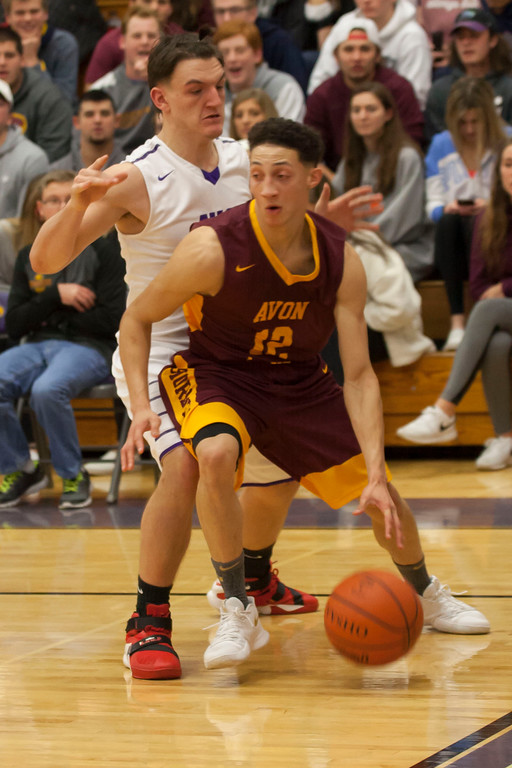 . Avon Lake guard Jordan Ball has to work hard to get by Avon\'s Mark Steinmetz on defense. Jen Forbus -- The Morning Journal