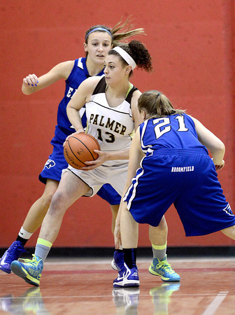 Broomfield's Katie Croell (left) and Nicole Lehrer (right) pressure Palmer's Shanah Leaf (middle) during their basketball game at Fairview High School in Boulder, Colorado December 14, 2012. BOULDER DAILY CAMERA/ Mark Leffingwell