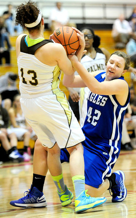 Broomfield's Stacie Hull (right) fights Palmer's Shanah Leaf (left) for a rebound during their basketball game at Fairview High School in Boulder, Colorado December 14, 2012. BOULDER DAILY CAMERA/ Mark Leffingwell