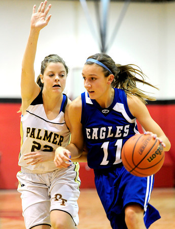 Broomfield's Katie Croell (right) works the ball past Palmer's Molly Myers (left) during their basketball game at Fairview High School in Boulder, Colorado December 14, 2012. BOULDER DAILY CAMERA/ Mark Leffingwell