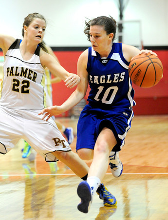 Broomfield's Bri Wilbur (right) is guarded by Palmer's Molly Myers (left) during their basketball game at Fairview High School in Boulder, Colorado December 14, 2012. BOULDER DAILY CAMERA/ Mark Leffingwell