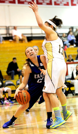 Broomfield's Nicole Croell (left) collides with Palmer's Shanah Leaf (right) during their basketball game at Fairview High School in Boulder, Colorado December 14, 2012. BOULDER DAILY CAMERA/ Mark Leffingwell