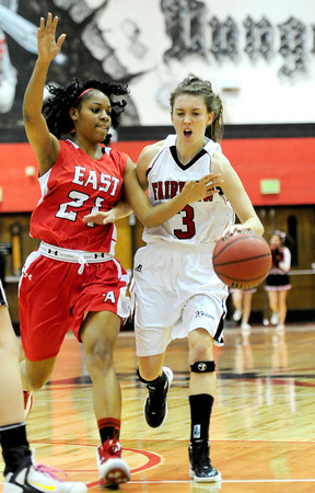 Fairview's Katie Kuosman (right) bumps Denver East's Jau'Nae Peevy (left) during their basketball game at Fairview High School in Boulder, Colorado December 14, 2012. BOULDER DAILY CAMERA/ Mark Leffingwell