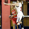 Fairview's Katie Kuosman (right) blocks Denver East's Michelle Cox (left) during their basketball game at Fairview High School in Boulder, Colorado December 14, 2012. BOULDER DAILY CAMERA/ Mark Leffingwell