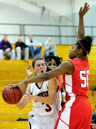 Fairview's Katie Kuosman (left) is fouled by Denver East's Khadijah Vigil (right) during their basketball game at Fairview High School in Boulder, Colorado December 14, 2012. BOULDER DAILY CAMERA/ Mark Leffingwell