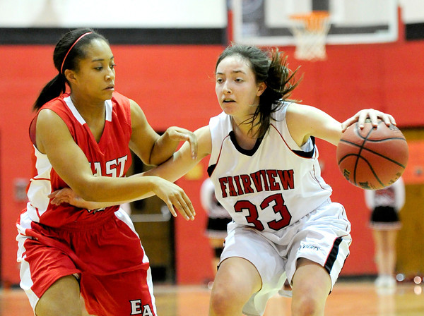 Fairview's Sarah Kaufman (right) is pressured by Denver East's Lyric Calhoun (left) during their basketball game at Fairview High School in Boulder, Colorado December 14, 2012. BOULDER DAILY CAMERA/ Mark Leffingwell