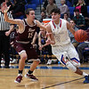 Bay's Max Showalter drives the baseline past Noah Steele of Rocky River during the second quarter. Randy Meyers -- The Morning Journal