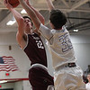 Zach Waite of Rocky River shoots and scores over Bay's Christian Dupps during the first quarter. Randy Meyers -- The Morning Journal