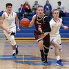 Rocky River guard Josh Ranc brings the ball up court against pressure applied by Bay's Erik Painter, right, and Max Showalter. Randy Meyers -- The Morning Journal