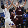 Rocky River's Zach Waite and R.J. Sunahara of Bay battle for a rebound during the second quarter. Randy Meyers -- The Morning Journal