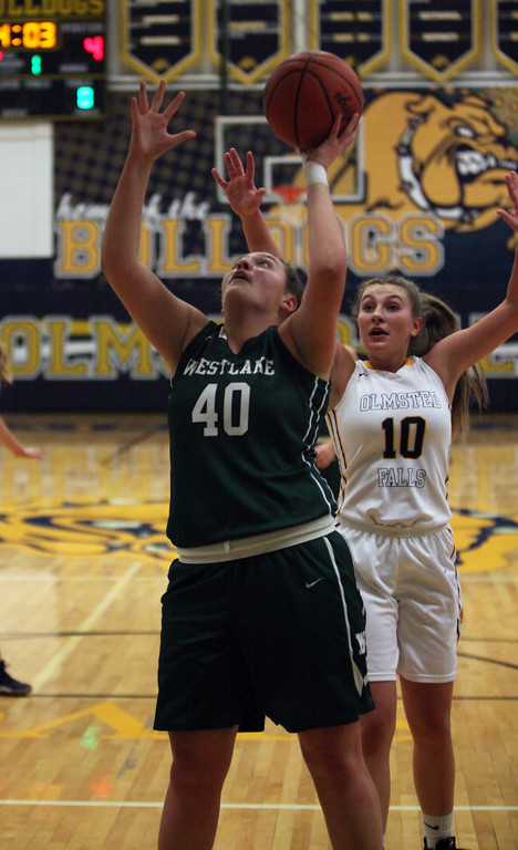 . Westlake\'s Angela Campo grabs a rebound and puts up a shot in front of Danielle Stevens of Olmsted Falls during the first quarter. Randy Meyers -- The Morning Journal