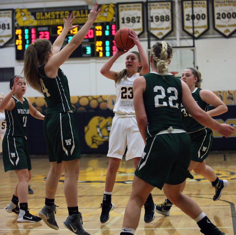 . Lauren Galaska of Olmsted Falls puts up a jumper in between three Westlake defenders during the second quarter. Randy Meyers -- The Morning Journal