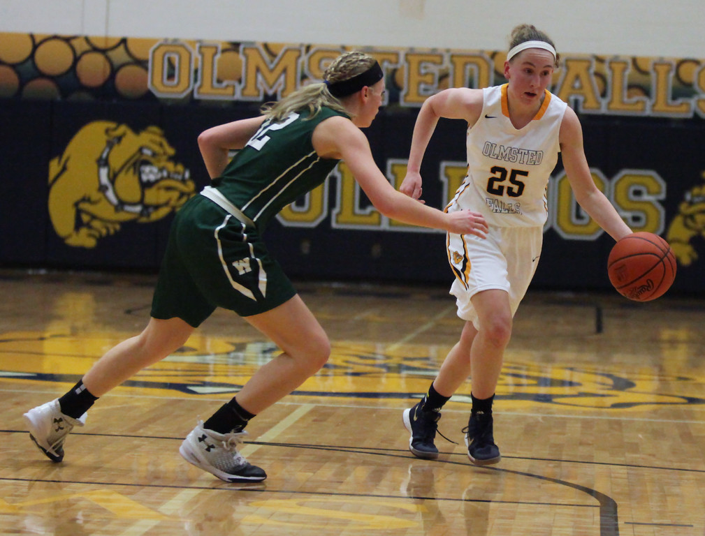 . Sarah Balfour of Olmsted Falls drives left past Abby Matalavage of Westlake during the second quarter. Randy Meyers -- The Morning Journal