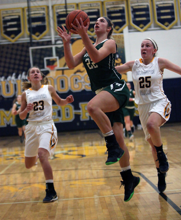 . Gina Adams of Westlake scores on a fast break in front of Sarah Balfour, right, and Lauren Galaska of Olmsted Falls during the first quarter. Randy Meyers -- The Morning Journal