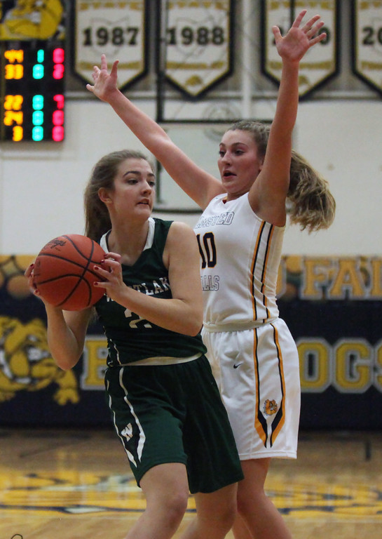 . Danielle Stevens of Olmsted Falls applies full court pressure against Melanie Rence of Westlake during the second quarter. Randy Meyers -- The Morning Journal