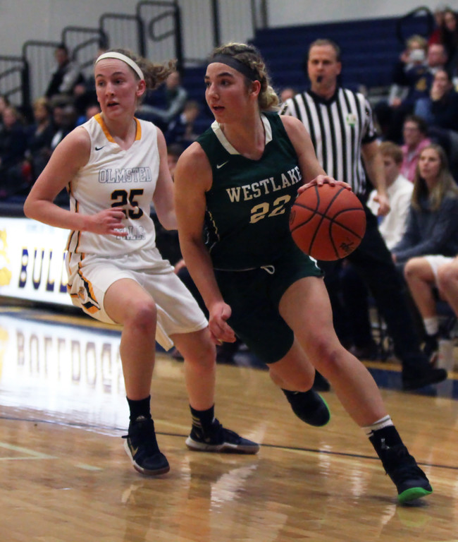 . Westlake\'s Gina Adams drives the baseline by Sarah Balfour of Olmsted Falls during the first quarter. Randy Meyes -- The Morning Journal