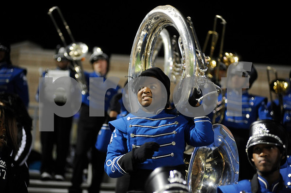photo by Sarah A. Miller/Tyler Morning Telegraph   John Tyler High School sousaphone player sophomore Shekaila Wright cheers with the Big Blue band at the beginning of the 4A Division 1 State Semifinal game at Midlothoian Stadium.