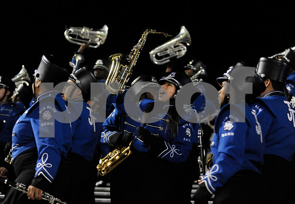 photo by Sarah A. Miller/Tyler Morning Telegraph   John Tyler High School saxophone player freshman Ericka Martinez cheers with the Big Blue band at the beginning of the 4A Division 1 State Semifinal game at Midlothoian Stadium.