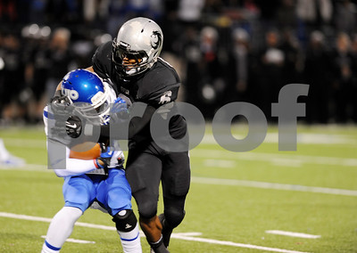 photo by Sarah A. Miller/Tyler Morning Telegraph  Guyer's (6) junior Demontrie Taylor tackles John Tyler's junior Reggie Gipson during the 4A Division 1 State Semifinal game at Midlothoian Stadium.