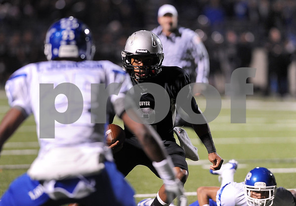photo by Sarah A. Miller/Tyler Morning Telegraph  Guyer's (2) junior Jerrod Heard is stopped by John Tyler's (25) senior Traven Smith during the 4A Division 1 State Semifinal game at Midlothoian Stadium.