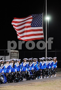 photo by Sarah A. Miller/Tyler Morning Telegraph  The John Tyler drill team Brigadettes at John Tyler's 4A Division 1 State Semifinal game stand underneath the American flag which was at half mast in honor of the adults and children killed in Newtown, Conn. that morning.
