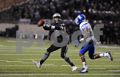 photo by Sarah A. Miller/Tyler Morning Telegraph   John Tyler's (13) junior Terry Ausborne tries to put a stop to Guyer's senior quarterback Mason McKnight at the beginning of the 4A Division 1 State Semifinal game at Midlothoian Stadium.