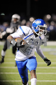 photo by Sarah A. Miller/Tyler Morning Telegraph  John Tyler's senior DeQuante Woods gains yardage in the first half of their game Friday night at Midlothian Stadium.