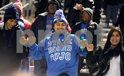 photo by Sarah A. Miller/Tyler Morning Telegraph   John Tyler High School seniors Gerardo Lopez, Emmanuel Gomez and Stacy Avila dance to the school song at the beginning of the 4A Division 1 State Semifinal game at Midlothoian Stadium.