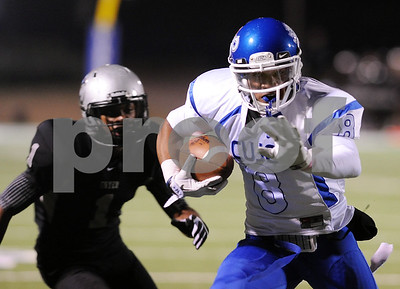 photo by Sarah A. Miller/Tyler Morning Telegraph  John Tyler's senior wide receiver Fred Ross keeps his eye on the end zone with Guyer's senior wide receiver Josh Harris close behind in the first half of their game Friday night at Midlothian Stadium.