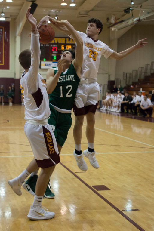 . Avon Lake post Creed Bologna goes vertical to block the shot from Westlake forward Neil McGrogan.Jen Forbus -- The Morning Journal
