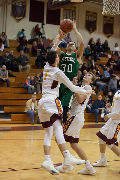 Despite a double block from Avon Lake's Nick Vittardi and Nate Sidloski, Demon Tim Waite goes up for a shot.Jen Forbus -- The Morning Journal