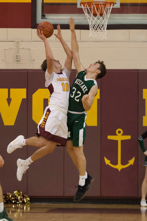 . Avon Lake\'s Nate Sidloski takes the ball to the net as Westlake\'s Steven Brewer positions himself for the block the shot. Jen Forbus -- The Morning Journal