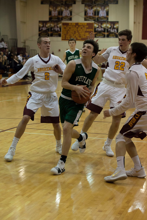 . Surrounded by Shoremen, Westlake guard Tommy Lazevinick purposefully charges toward the net. Jen Forbus -- The Morning Journal