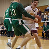 Westlake guard Billy Blood (13) puts himself between Avon Lake's Nick Marsh and the basket. Jen Forbus -- The Morning Journal
