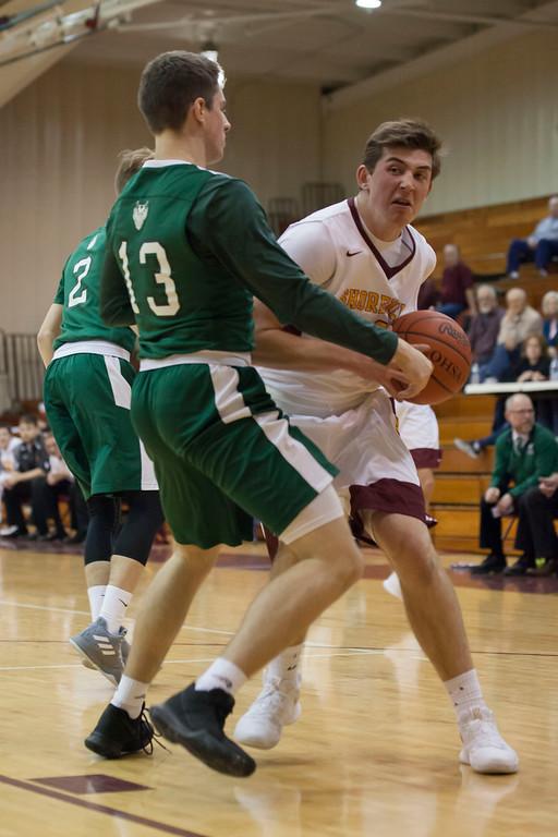 . Westlake guard Billy Blood (13) puts himself between Avon Lake\'s Nick Marsh and the basket. Jen Forbus -- The Morning Journal