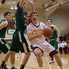 Shoreman post Nick Marsh attempts to drive the lane against Demon forward Anthony Rego. Jen Forbus -- The Morning Journal